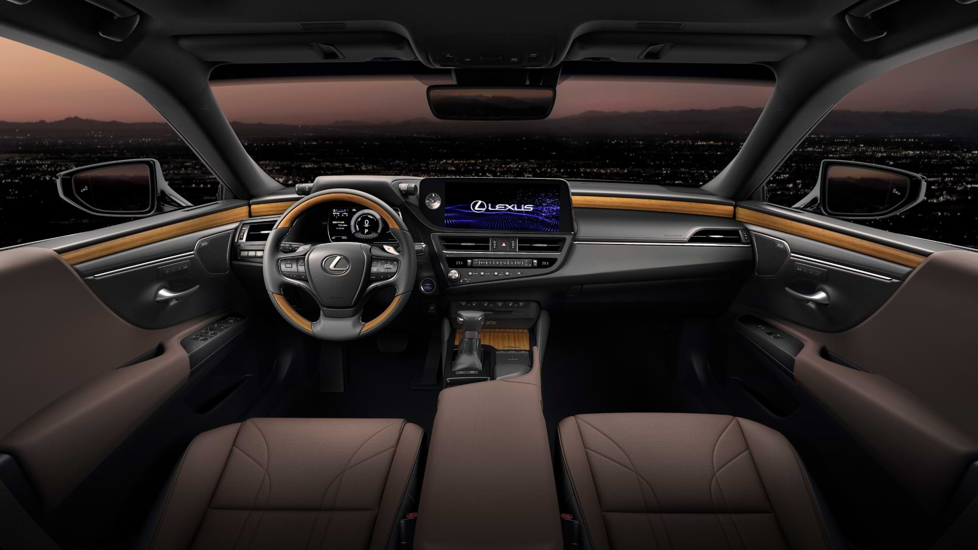 Interior view of 2021 Lexus ES steering wheel, dash and front seats.